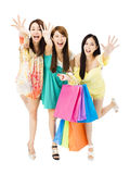Young woman group  with shopping bags running and catching Stock Photo