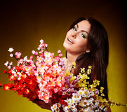 Young woman with group spring flower. Stock Photo