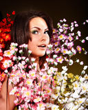 Young woman with group spring flower. Royalty Free Stock Image