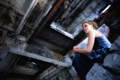 Young woman on grunge industrial background Stock Image