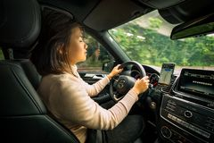Young woman guided by GPS while driving car royalty free stock photography