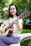 Young woman with guitar Stock Images