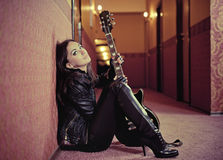 Young woman with guitar Stock Photos