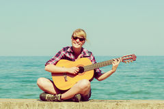Young woman with guitar outdoor Royalty Free Stock Images