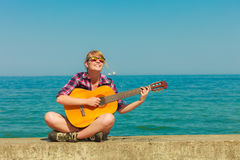 Young woman with guitar outdoor Stock Image