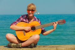 Young woman with guitar outdoor Royalty Free Stock Photo