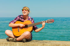 Young woman with guitar outdoor Stock Photo