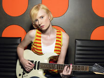 Young Woman With Guitar In Recording Studio Stock Images