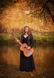 Young woman with guitar Royalty Free Stock Images