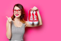 Young woman with gumshoes Royalty Free Stock Images