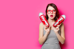 Young woman with gumshoes Stock Photo