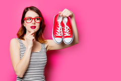 Young woman with gumshoes Royalty Free Stock Photo