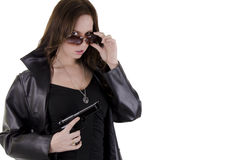Young woman with gun. (2) Stock Images