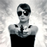 Young woman with gun. Retro style Royalty Free Stock Photos