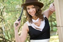 Young woman with a gun Royalty Free Stock Images