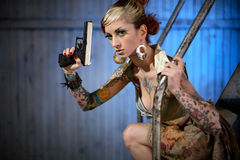 Young woman with gun stock photos