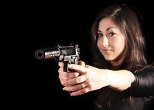 Young woman with gun on black Royalty Free Stock Images