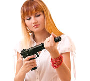 Young woman with gun isolated Royalty Free Stock Images