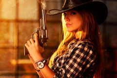 Young woman with gun Royalty Free Stock Photos