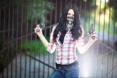 Young woman with guns Stock Photos