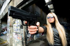 Young woman with guns royalty free stock photos