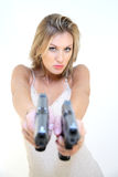 Young woman with guns Royalty Free Stock Images