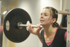 Young woman at the gym royalty free stock image