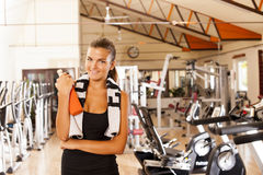 Young woman in gym. With bottle of water Royalty Free Stock Photography