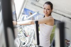 Young woman in the gym Royalty Free Stock Image