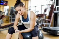 Young woman in the gym. Pretty young woman in the gym Stock Images