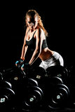 Young woman in a gym Royalty Free Stock Photos
