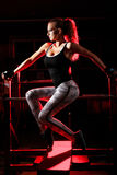 Young woman in a gym Royalty Free Stock Image