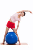 Young woman with gym ball isolated on white Stock Photo