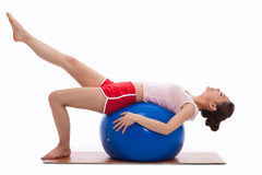 Young woman with gym ball isolated on white Royalty Free Stock Photography