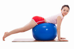 Young woman with gym ball isolated on white Royalty Free Stock Photos