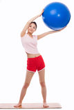 Young woman with gym ball isolated on white Royalty Free Stock Images