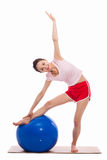 Young woman with gym ball isolated on white Stock Image