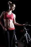 Young woman in a gym. Beautiful young woman in a gym royalty free stock image