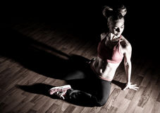 Young woman in a gym. Beautiful young woman in a gym royalty free stock photos