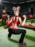 Young woman in a gym. Beautiful young woman in a gym stock photo