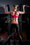 Young woman in a gym. Beautiful young woman in a gym royalty free stock photography