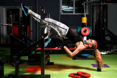 Young woman in a gym. Beautiful young woman in a gym stock images