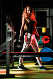 Young woman in a gym. Beautiful young woman in a gym royalty free stock images