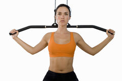 Young woman in gym, cut out Royalty Free Stock Images