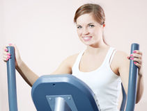 Young woman at the gym exercising. Royalty Free Stock Photo