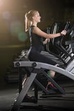 Young woman at the gym exercising. Run on machine. Royalty Free Stock Photography