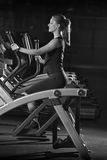 Young woman at the gym exercising. Run on machine. Royalty Free Stock Images