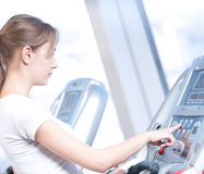 Young woman at the gym exercising. Running Stock Images