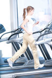 Young woman at the gym exercising. Running Royalty Free Stock Photo
