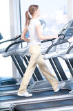 Young woman at the gym exercising. Running Royalty Free Stock Photography